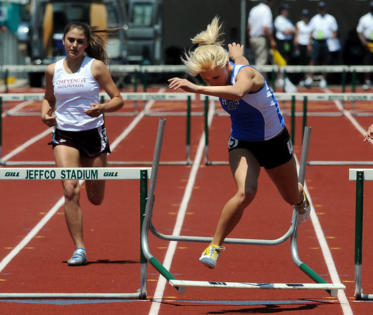 Ashley Mikinis of Broomfield was winning the  300m hurdles, when she hit the last one and finished second at State.<br /> Cliff Grassmick / May 16, 2009