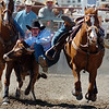 Keenan Walhert tries his hand at steer wrestling during the senior boys competition on Sunday.<br /> The 2009 Little Britches Rodeo was held this weekend at the Boulder County Fairgrounds in Longmont and was sponsored by the Elks #1055 Lodge.<br /> <br /> <br /> Cliff Grassmick / June 28, 2009