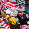 Rishab Karki 2, enjoys waving the U.S. flag while wearing traditional Nepali clothing.<br /> Local Nepalese celebrated the Nepal New Year of 2066 with a parade around downtown Boulder, Japanese drums on the Pearl Street Mall, and  with food and a cultural program in Boulder.<br /> Cliff Grassmick / April 19, 2009