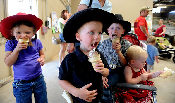 "Ice cream for everyone!<br /> Caroline Bishop, left, 5, Joshua, 3, Caleb 7, and Elisa, 21-months, all of Lyons, eat ice cream while watching cattle showing at the fair on Friday.<br /> The Boulder County Fair continues this weekend at the fairgrounds in Longmont.<br />  For more photos, go to  <a href=""http://www.dailycamera.com"">http://www.dailycamera.com</a>. <br /> Cliff Grassmick / August 7, 2009"