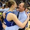 Broomfield_Mullen_Girl_(2).JPG Broomfield_Mullen_Girl_s_State_4A_Championship_basketball_COBOU101.jpg Anna Prins hugs her coach Mike Croell after the Eagle won the 4A State Championship.<br /> Cliff Grassmick / March 13, 2009