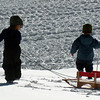 Bode Bodan, 2, left, and Noah Bachman, 3, are taking their sled and going home.<br /> Friday, November 20, 2009, was opening day at the Eldora Mountain Resort.<br /> Cliff Grassmick / November 20, 2009