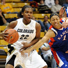 Colorado__Kansas_NCAA_Women.JPG Colorado__Kansas_NCAA_Women_s_basketball_COBOU103.jpg Brittany  Spears of Colorado drives past Aishah Sutherland of Kansas, during the first half of the February 18, 2009 game in Boulder.<br /> Cliff Grassmick / February 18, 2009