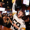 "N0202SUP34.JPG N0202SUP34.JPG Matt D'Ella, right, is working the Steelers ""Terrible Towel"" as it appears the steelers scored a touchdown in the first quarter of the Super Bowl. Gavin Levy is on the left.<br /> The Lazy Dog Saloon was packed with Super Bowl watchers on Sunday.<br /> Cliff Grassmick / February 1, 2009"