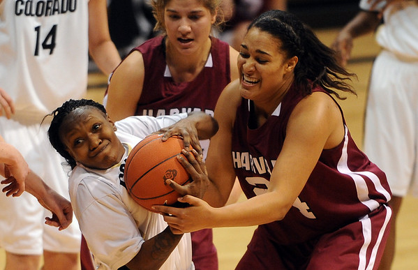 Whitney Houston, left, of CU, and Claire Wheeler of Harvard try to get control of the ball.<br /> <br /> Cliff Grassmick /November 28, 2009