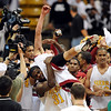 Colorado_State_Boys_Bas(7).JPG Colorado_State_Boys_Basketball_Championship_COBOU101.jpg Kelby Dias is picked up by  teaamate Clarence Bumpas after their team, Sierra High School beat Pueblo South to win the Colorado 4A State Championship on march 14, 2009 in Boulder.<br /> Cliff Grassmick / March 14, 2009
