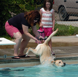 Linda Myers had to give Oliver the dog a little help getting in the pool. Dogs and owners were able to have some wet fun during Dog Dayz at Scott Carpenter Pool in Boulder on Sunday.  Dog Dayz will continue through September 7, check www.BoulderParks-Rec.org for the  daily schedule. For more photos and a video, go to www.dailycamera.com. Cliff Grassmick / August 23, 2009
