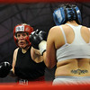 "Tawnia Wormell, left, 42,  throws a punch at Rachel Griego in her first professional fight on November 6th at the Softball Country arena in Denver.<br /> For more photos and a video of Tawnia, go to  <a href=""http://www.dailycamera.com"">http://www.dailycamera.com</a>.<br /> Cliff Grassmick / November 12, 2009"