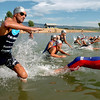 """Matt Reed, left, takes off with the other pro men at the Boulder Peak. He raced and won the day before in Minnesota.<br /> The Boulder Peak Triathlon was held at the Boulder Reservoir on Sunday.<br /> For more photos, check the photo galleries at  <a href=""""http://www.dailycamera.com"""">http://www.dailycamera.com</a>.<br /> <br /> Cliff Grassmick / July 12, 2009"""