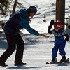 "Steve Fisk of Longmont, gets a high five from his son, Stephen, 4, after Stephen stayed up on his skis as he was learning to ski for the first time.<br /> Friday, November 20, 2009, was opening day at the Eldora Mountain Resort.<br /> For more photos and a video of Eldora, go to  <a href=""http://www.dailycamera.com"">http://www.dailycamera.com</a>.<br /> Cliff Grassmick / November 20, 2009"