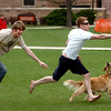 Jason Jauregui, right, reaches out for a pass   from Ted Doykos, as Jeremy Hoover defends with help from Sunshine the Dog. These guys spent Sunday relaxing before finals start.<br /> Cliff Grassmick / April 26, 2009