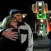 "Melissa Holland gets a hug from her boyfriend Arron Mansika in front of the Pearl Street Courthouse that  was just lit up.<br /> Downtown Boulder Switched on the holidays on Pearl Street Saturday night. Santa, Mrs. Claus, and the musical group ""Face"" helped turn on the Christmas light at the courthouse and the Mall. For a video of the event, go to  <a href=""http://www.dailycamera.com"">http://www.dailycamera.com</a>.<br /> Cliff Grassmick / November 21, 2009"