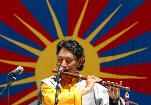 "Nawang Khechog plays his flute to open up the festivities of World Tibet Day.<br /> Boulder celebrated the 7th annual World Tibet Day in Central Park. The City of Boulder also declared the day as  ""Dalai Lama and Tibet Awareness Day.""<br /> <br /> Cliff Grassmick / July 11, 2009"
