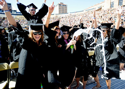 Kristen Jorgensen pops the cork on a bottle of champagne  with her friends during their graduation celebration. About 5,280 degrees were conferred Friday  during the 2009 University of Colorado Spring Commencement at Folsom Field. Cliff Grassmick / May 8, 2009