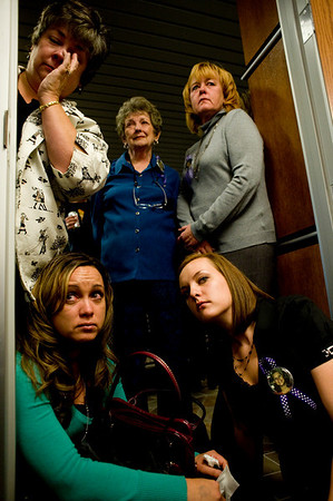 (From left to right) Charlene McLeod, Katherine McLeod,  Ginger McLeod, Michelle Strick (bottom left) and Samantha McLeod, family members of victim Kaysi McLeod, listen to a recording of Scott Lee Kimball's court hearing at the Boulder County Justice center in Boulder, Colorado Thursday, Oct. 8, 2009. Kimball pleaded guilty to the murder of four people and was sentenced 70 years. <br /> KASIA BROUSSALIAN / THE CAMERA