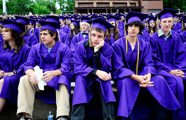BHS_Grad___COBOU101.jpg Cameron Barron, 18, rests his head on his hand during the Boulder High School commencement ceremony at Recht Field in Boulder, Saturday, May 23, 2009.<br /> KASIA BROUSSALIAN /CAMERA