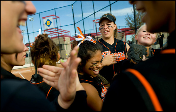 Erie's Sasha Duran-Fong (center) sings and dances beforethe start of the Class 3A State Championships at Aurora Sports Park in Aurora Saturday, Oct. 24, 2009. Erie won the championships, 8-0.  <br /> KASIA BROUSSALIAN / THE CAMERA