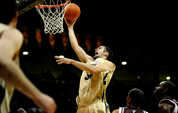 CU's Casey Crawford (34) goes up for a basket during the game against Texas A&M at the Coors Event Center on the University of Colorado campus in Boulder on Wednesday, March 4, 2009.<br /> <br /> KASIA BROUSSALIAN / THE CAMERA