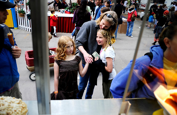 N0524CREEK048.jpg Ann Hill, of Broomfield, embraces her daughters Sydney Brookstein, 9, (left) and Georgia Brookstein as they wait to order a funnel cake at the Boulder Creek Festival in Boulder, Saturday, May 23, 2009. In its 22nd year, the festival is widely considered the unofficial kickoff to summer throughout the Boulder community.<br /> KASIA BROUSSALIAN /CAMERA