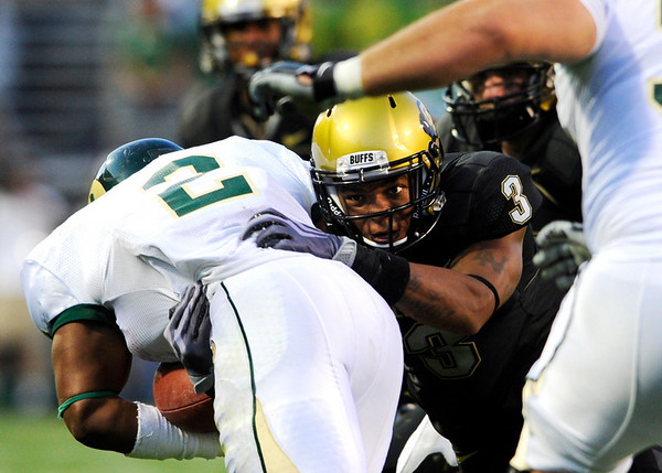 CU's Jimmy Smith (3) tackles CSU's Leonard Mason (2) at the annual Rocky Mountain Showdown in Folsom Field in Boulder, Colorado on Sunday, Sept. 6, 2009.<br /> KASIA BROUSSALIAN / THE CAMERA