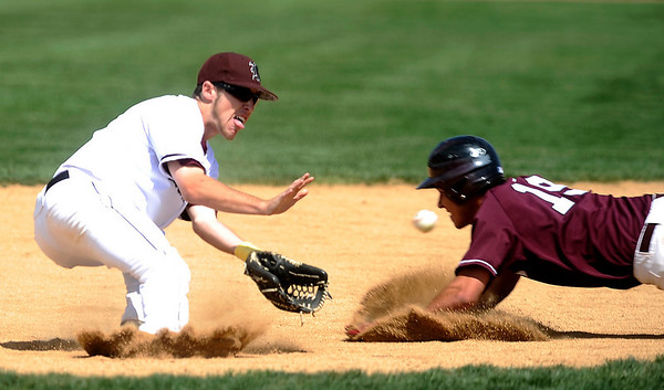S0516BASE002.JPG Silver Creek's Tyler Gibbons (8) reaches for the ball as Cheyenne Mountain's David Thomas (19) slides to second base during the class 4A state semifinals at All-Star Park in Lakewood Friday afternoon. The Raptors lost 2-1.<br /> KASIA BROUSSALIAN /CAMERA