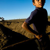 "A Nicaraguan boy breaks from filling in dirt over a pipe for the ""Just Hope Water Project"" in Chacraseca, Nicaragua, March 25, 2009. ""Just Hope Water"" is the first pipeline seeking to provide over 1,000 families with clean, dependable water."