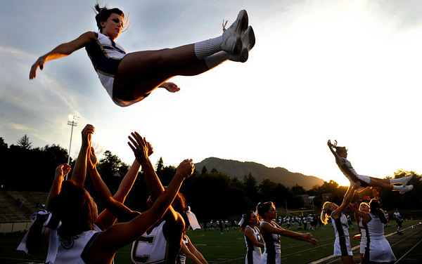 S0918BHS001.JPG  Fort Collins cheerleaders warm up before the game with Boulder at Recht Field at Boulder High School in Boulder Thursday, Sept. 17, 2009.<br /> <br />  DAILY CAMERA/ Kasia Broussalian