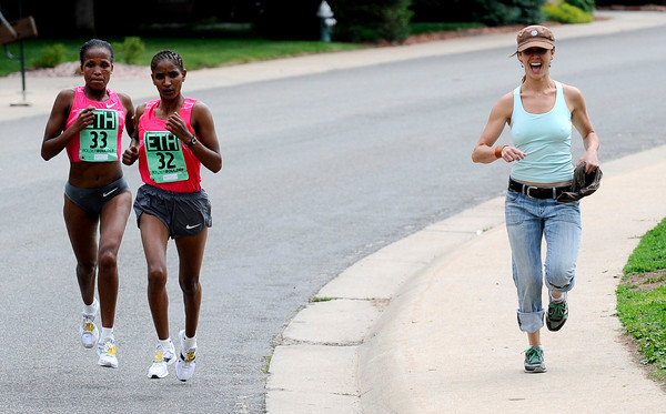 0526BB8.JPG A spectator laughs while trying to keep pace with Ethiopia's Teyba Erkesso (left) and Mamito Daska (right) Women's Elite the 31st annual Bolder Boulder Memorial Day 10k run in Boulder, Colorado May 25, 2009  CAMERA/Mark LEFFINGWELL