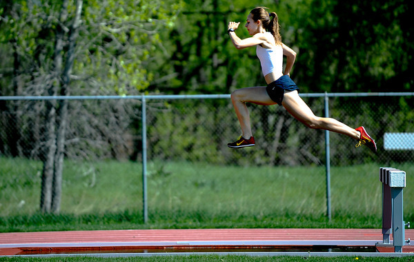 Jenny Barringer (cq) leaps off the the obstacle during her steeple chase workout at Pott's Field at the University of Colorado in Boulder, Colorado May 12, 2009. CAMERA/Mark Leffingwell