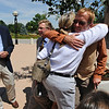 N0807POT02.JPG N0807POT02<br /> Jason Lauve, right, is hugged by a juror (who refused to give her name) after his trial ended at the Boulder County Justice Center on Thursday. Lauve, who was accused of possessing an illegal amount of medical marijuana when his home was raided last year, was acquitted on all charges. At left is jury foreman Roger Grady.<br /> Photo by Marty Caivano / The Camera / August 6 , 2009