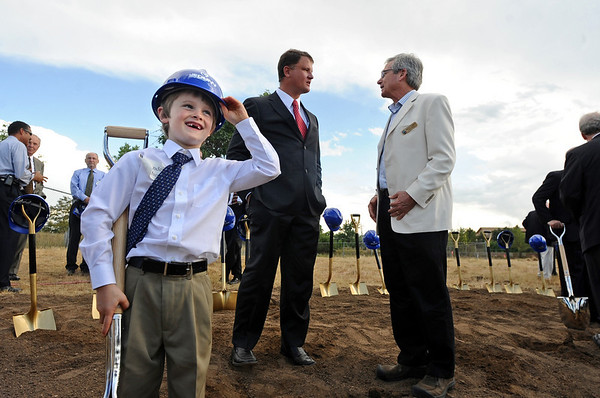 CUBLDG02.JPG CUBLDG02<br /> Alexander Carruthers, 6, left, tries on a hard hat after his father, Jonathan, center, took part in a groundbreaking ceremony Wednesday for the University of Colorado's Jennie Smoly Caruthers Biotechnology Building. At right is city councilman Macon Cowles.<br /> <br /> *****LEDE******<br /> <br /> Photo by Marty Caivano/Camera/Sept. 9, 2009