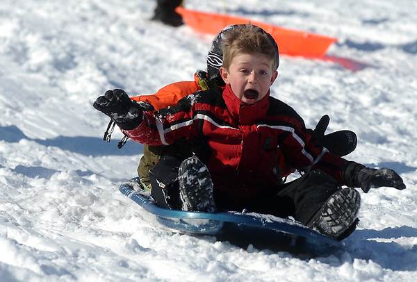 SLEDDING.JPG SLEDDING<br /> Conor Byrt, foreground, takes on the sledding hill at Scott Carpenter Park on Thursday with his best friend, Fletch Barr. <br /> <br /> Photo by Marty Caivano/Camera/Dec. 24, 2009