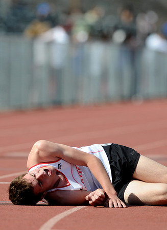BOULDER_COUNTY_TRACK_MEET_.jpg S0421TRACK10<br /> Fairview's Lewis Commons collapses on the track after running the 1600 at the Boulder County Track and Field Championships in Longmont.<br /> <br /> <br /> <br /> photo by Marty Caivano/April 20, 2009