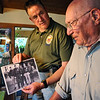 N0510BOWER03.JPG N0510BOWER03<br /> Bill Bower, right, one of Doolittle's Raiders, looks at a photo of himself with some of his crew members while talking to Jack Gardner, left, whose father trained for the mission but did not participate. <br /> Photo by Marty Caivano/April 29, 2009