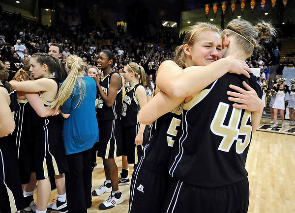 MONARCH_STATE_CHAMPIONSHIPS_.jpg S0314MON07KK<br /> CMYK<br /> Monarch players Alex Houck, left, and Lindsay Harder hug each other after their 44-37 loss to Regis Jesuit in the 5A State Championship matchup at Coors Events Center on Friday night.<br /> <br /> photo by Marty Caivano/March13, 2009