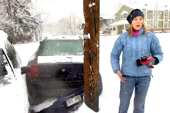 COBOU101.JPG COBOU101.JPG Melissa Lester reacts after her car slid down an icy hill on 9th Street and slid into another vehicle stuck in the snow during a Monday morning snowstorm in Boulder, Colo. January 12, 2009.<br /> Photo by Paul Aiken January 12, 2009