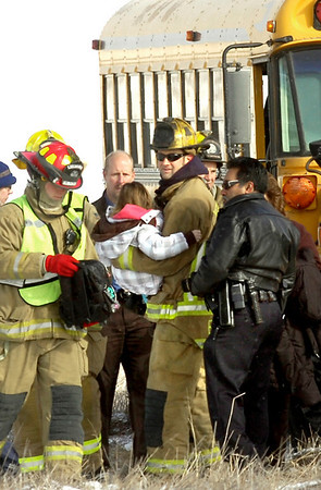 "BUS.jpg Firefighters carry an injured child off a school bus that was involved in an accident on E. County Line Road Tuesday morning. VIDEO: Watch the scene of the accident at  <a href=""http://www.dailycamera.com"">http://www.dailycamera.com</a> Photo by Paul Aiken / The Camera / March 10, 2009"