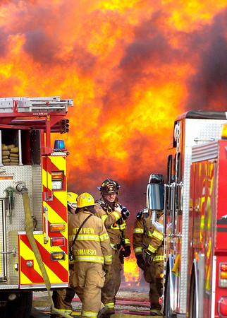 FIRE1.jpg Firefighters can only watch as a house north of Boulder Colo. burns after a wind-blown grass fire moved past on Wednesday January 7, 2009. Small grass fires caused home evacuations and closures of roads in the area between Lyons, Colo and Boulder, Colo.<br /> Photo by Paul Aiken / The Camera / Boulder Colorado