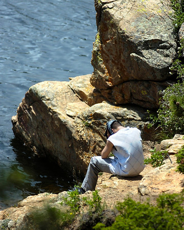 "03cdlcu1.jump.jpg DROWN113.JPG A friend of the drowning victim in Barker Reservoir in Nederland sits beside the water while rescuers search for the missing fisherman on Thursday afternoon. For more photos and a video from the scene go to  <a href=""http://www.dailycamera.com"">http://www.dailycamera.com</a>.<br /> Photo by Paul Aiken / The Camera / JULY 1, 2009"