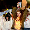 "hallow2222.JPG Marsha Steckling, at left and fellow zombie Jeanne Steckling grab a ""victim"" as part of their Zombie Mall Crawl on the Pearl Street Mall Halloween evening.<br /> Photo by Paul Aiken"