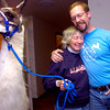GOLDSMITH.jpg Bobra Goldsmith gets a welcoming hug from Steve Carson at her benefit on Thursday evening in Boulder. Carson, whose daughter has been volunteering at Goldsmith's llama ranch for about 5 years, had raced to help evacuate llamas from the January fire that destroyed Goldsmith's home. The benefit and silent auction was held at The Villas at the Atrium.<br /> Photo by Paul Aiken / The Camera