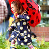 RAIN253.JPG Novi Spielman, 5, looks for puddles to avoid and jump into as she walks around the Pearl Street Mall in her spring rain fashion including a ladybug umbrella. Speilman just finished her pre-school education and is off for the summer in preparation to enter kindergarten. <br /> Photo Paul Aiken / The Daily Camera / JUNE 2, 2009