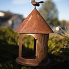 Bird feeder/house in front garden at 533 Old Stone Drive