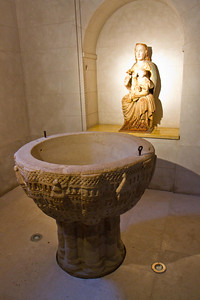 A Romanesque baptismal font at Redecilla del Camino which depicts Jerusalem.