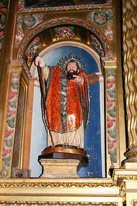 John the Baptist holds his severed head in the church of Santa María in Belorado.