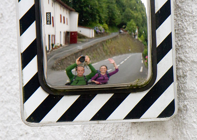 David Landis and Anna Dintaman, authors of Hiking the Jesus Trail, have some fun with traffic mirrors in Arneguy, on the French/Spanish border on the Camino de Santiago.