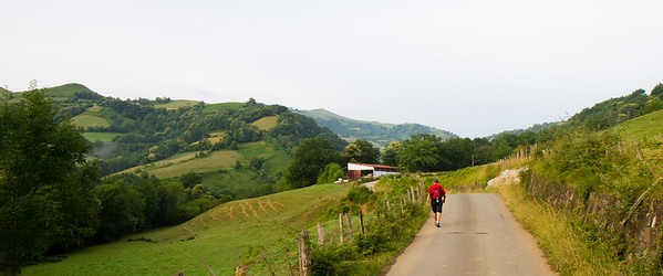 A pilgrim sets out from St-Jean-Pied-de-Port, France, on the Valcarlos route over the Pyrenees to Roncesvalles, Spain.