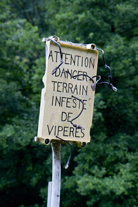 "A sign reads ""Attention: Danger, the ground is infested with snakes"" along the Varcarlos route between St-Jean-Pied-de-Port, France and Roncesvalles, Spain.  We did not see any snakes."