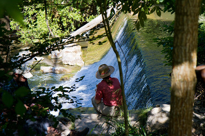 A pilgrim on the Camino de Santiago rests by a small waterfall soon after Larrasoaña.