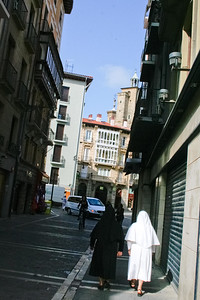 Nuns walk toward the cathedral in the Spanish city of Pamplona, along the Camino de Santiago.